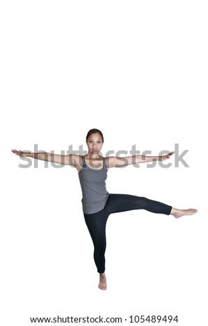 A beautiful woman doing her Yoga stance exercises - stock photo