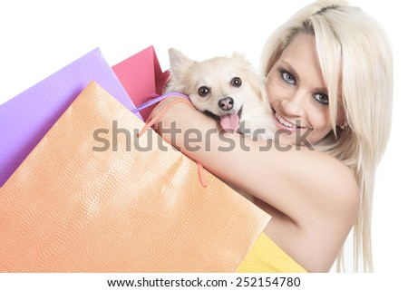 A Beautiful woman friends fashion, holding dog in studio gray background - stock photo
