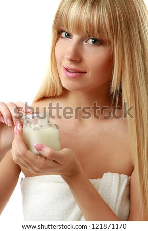A beautiful woman holding a bottle of cream, isolated on white - stock photo