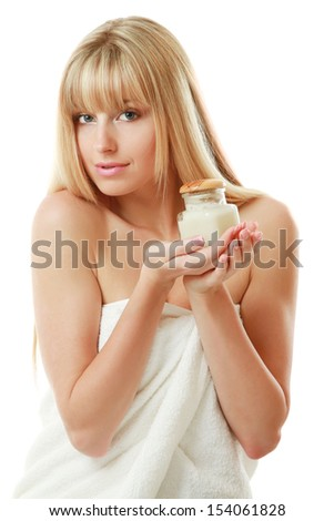 A beautiful woman holding a bottle of cream, isolated on white background - stock photo