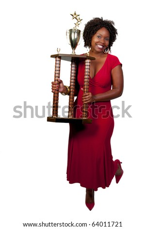 A beautiful woman holding a large trophy - stock photo