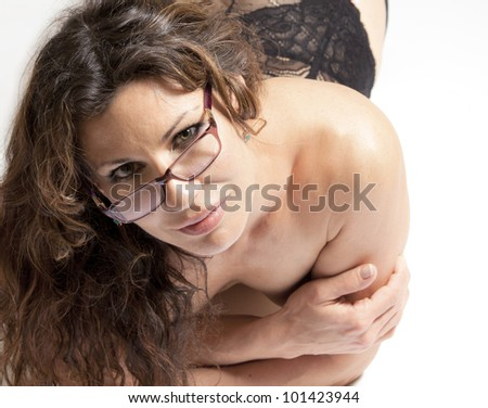 A beautiful woman in glasses and lingerie looking up at you - stock photo