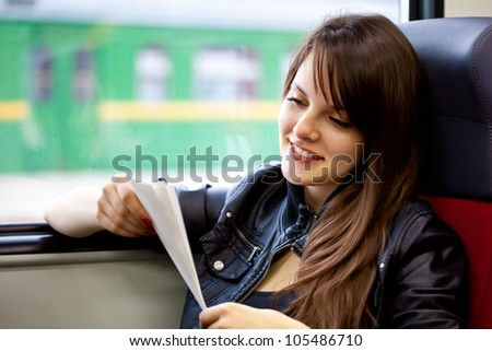A beautiful woman in the train with ticket in her hands