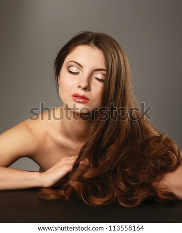 A beautiful woman isolated on grey background