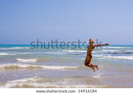 a beautiful woman on the beach in Mediterranean