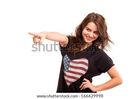 A beautiful woman pointing to something, isolated over a white background
