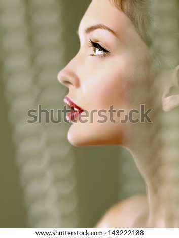 A beautiful woman, portrait isolated on grey background - stock photo