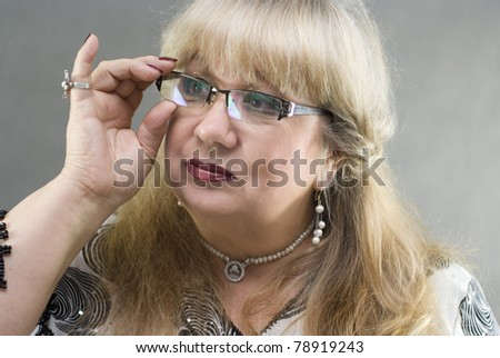A beautiful woman posing with glasses - stock photo