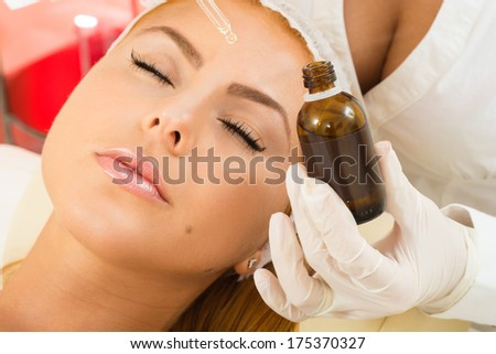 a beautiful woman receiving a facial treatment