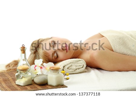 A beautiful woman relaxing in a spa center - stock photo