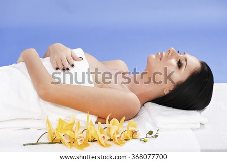 A beautiful woman relaxing in spa - stock photo