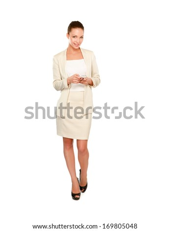 A beautiful woman using a mobile phone, isolated on white background - stock photo