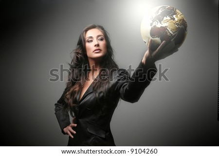 A beautiful woman with a globe - stock photo