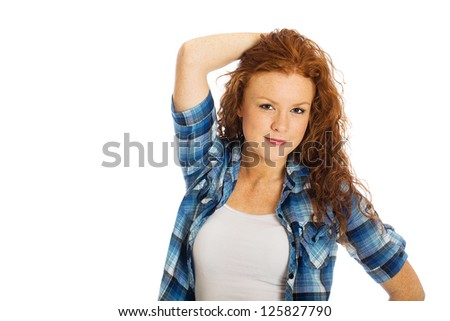 A beautiful woman with natural red hair. - stock photo