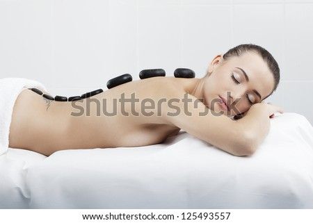 A beautiful woman with perfect skin is spa massage therapy in clinic