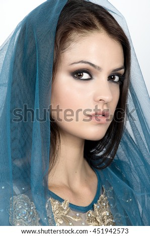 A beautiful women under blue veil. Beauty portrait