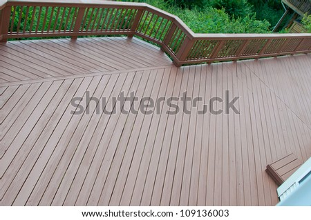 A beautiful wood deck after application of fresh paint and stain.