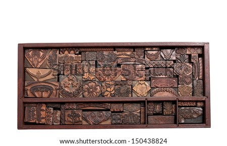 A Beautiful Wood Tray of Antique Copper Letterpress Printing Blocks - stock photo