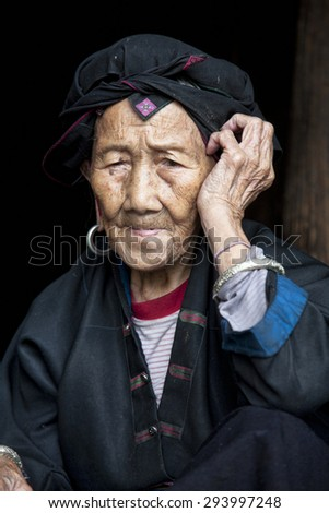 A beautiful 96 year old woman from the Hong Yao ethnic group living in the village of Dazhai, part of the Dragon's Backbone Rice Terraces, Longji. Guangxi Zhuang Autonomous Region. Guilin, China - stock photo