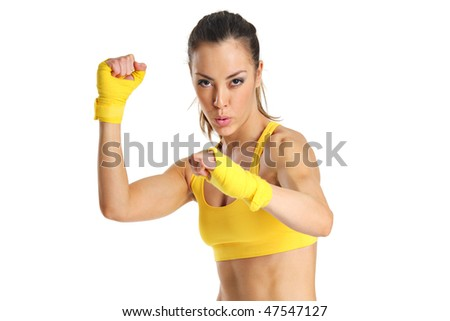A beautiful young aerobics instructor isolated on a white background - stock photo