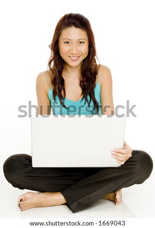 A beautiful young asian woman sitting with her laptop