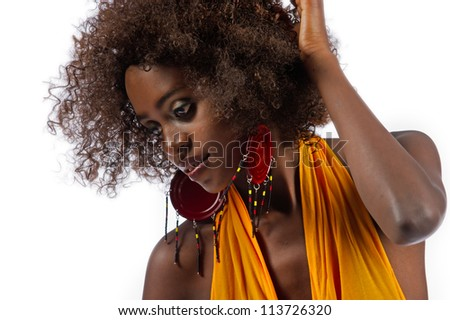 A beautiful young black woman runs her fingers through her hair isolated on a white background. - stock photo