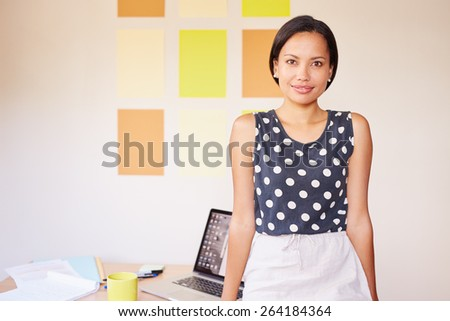 A beautiful young designer smiling at the camera - stock photo