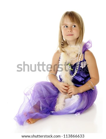 A beautiful young elementary girl looking beautiful in a purple dress, beads and a  pale pink boa.  On a white background.