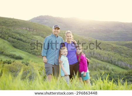 A beautiful young family hiking on a nice scenic evening in the rocky mountains of Utah in the United States of America - stock photo