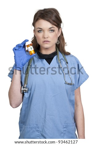 A beautiful young female doctor on her rounds holding a pill bottle of prescription medication - stock photo