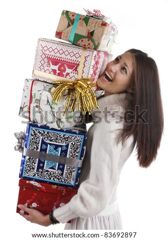 A beautiful young female overjoyed, holding/carrying many gifts in her hands