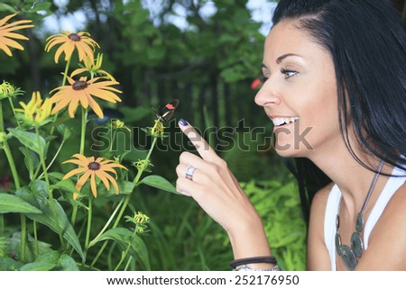 A Beautiful young female with colorful butterfly - stock photo
