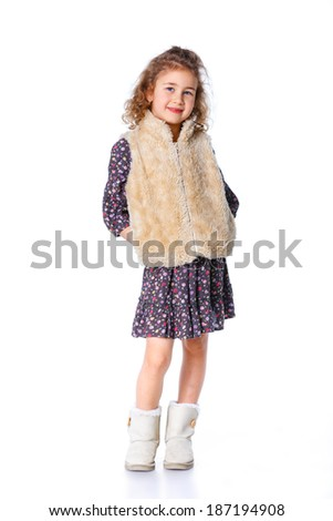 A beautiful young girl dressed for winter, over a white background