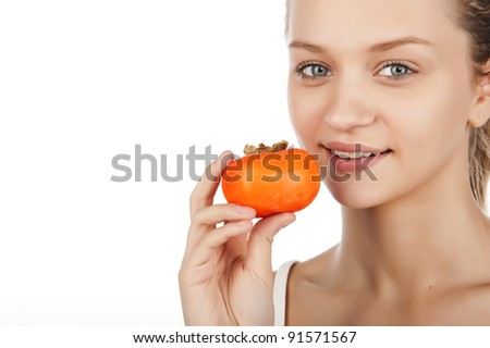 a beautiful young girl holds a delicious persimmon, a portrait of a beautiful young girl with fruits, isolated on white