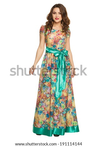 a beautiful young girl in a long dress posing on a white background