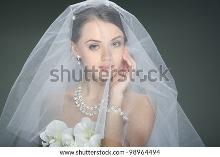 A beautiful young girl is in a wedding decoration - stock photo