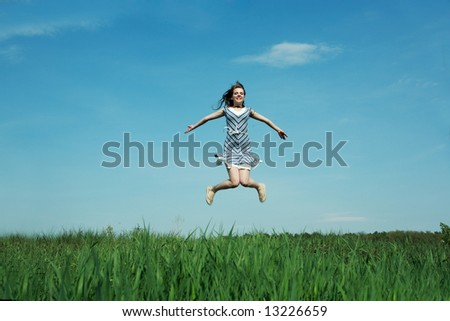 A beautiful young girl jumps