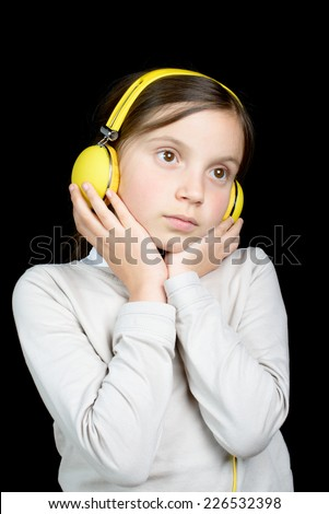 a beautiful young girl listening to music with headphones