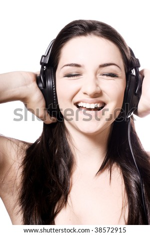 A beautiful young girl smiling and wearing headphones on a white background.