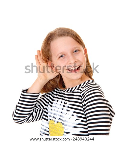 A beautiful young girl standing for white background with her hand on her ear, she can not hear.  - stock photo