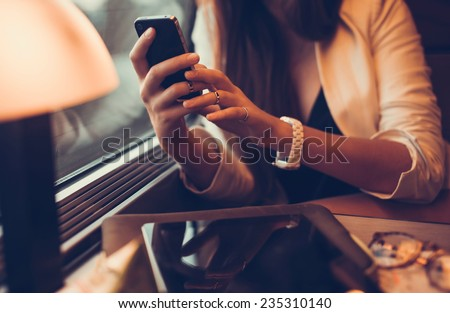 a beautiful young girl who works in the train on your phone - stock photo