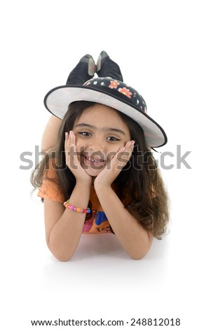 A Beautiful Young Girl with Hat Lying Down Isolated on White background - stock photo