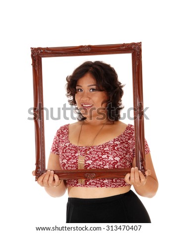 A beautiful young mixed raced woman holding an picture frame