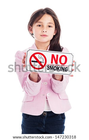 A beautiful young nine year old girl holding a no smoking sign. Isolated on a studio white background. A warning and an instruction. - stock photo