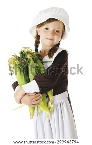 A beautiful young Pilgrim girl carrying an armload of fresh corn.  On a white background.