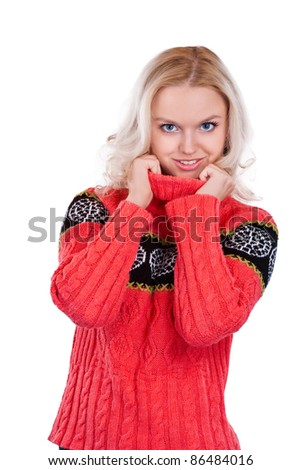 A beautiful young smiling girl in her winter warm clothing