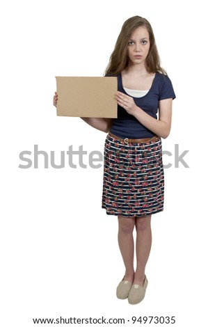 A beautiful young teenager woman holding up a blank sign - stock photo