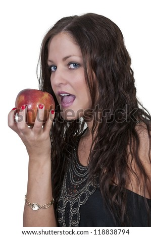 A beautiful young woman eating a fresh delicious apple