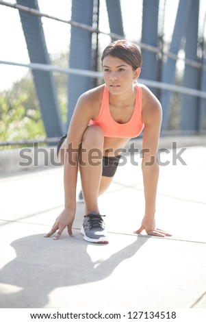 A beautiful young woman exercising outdoors. - stock photo