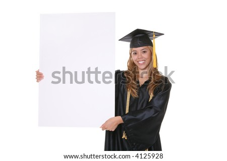 A beautiful young woman graduate holding a sign